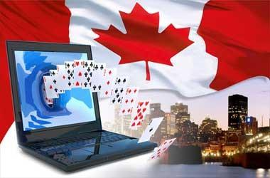 A deck of cards coming out of a laptop with the casino flag.